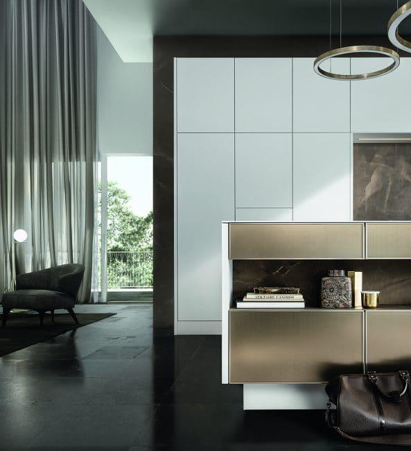 Der filigrane Rahmen der PURE-Küchenfront aus Metall, Holz und Mattlack. Küche: SieMatic.