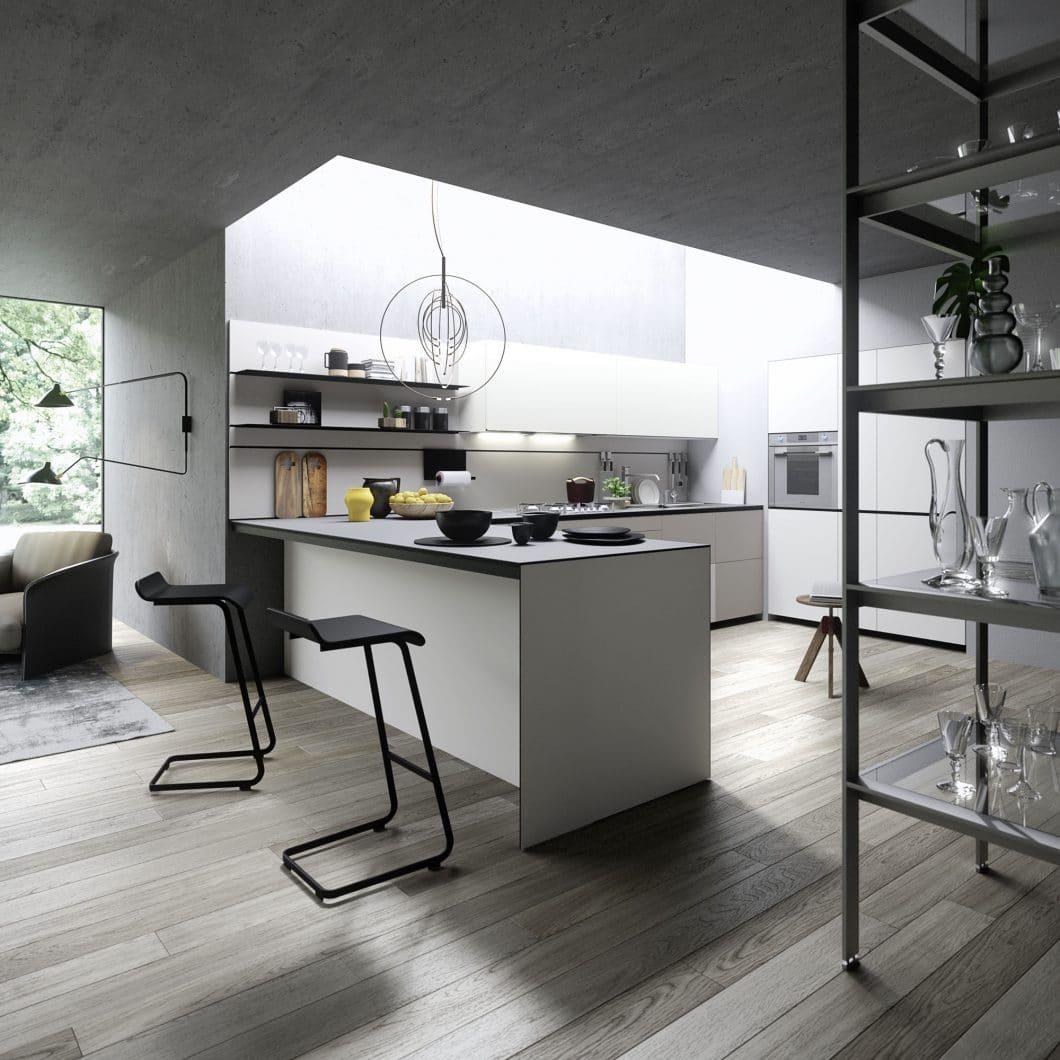 Theke statt Tisch: Am Tresen der eigenen Kücheninsel lässt es sich auch rasch und elegant speisen. (Foto: Valcucine, Forma Mentis)