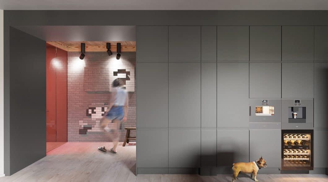 Die hochwertige Küche wird mit einer eleganten, flächenbündigen Gerätewand von Gaggenau abgeschlossen. Auch ein Weinklimaschrank darf nicht fehlen. (Foto: Martin Architects/ Home Designing)