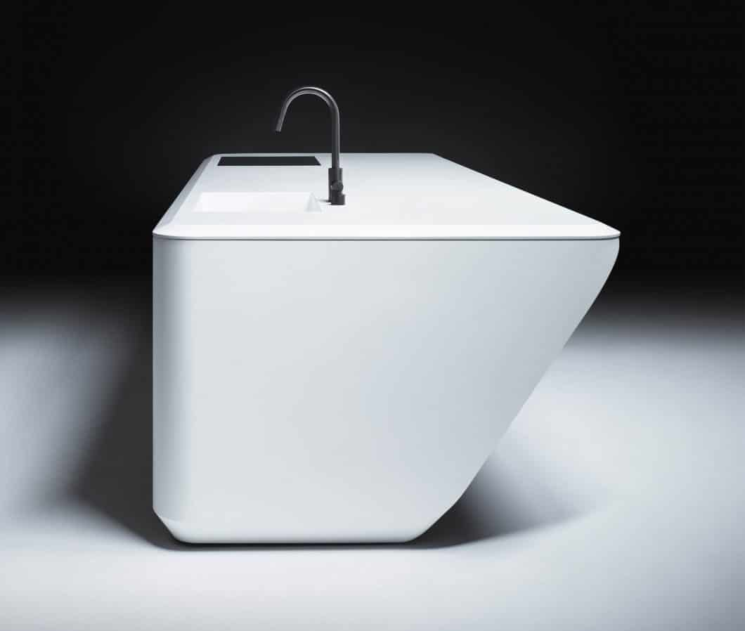 Der Mineralwerkstoff Corian ist thermisch verformbar - und erlaubt dadurch Objekte, die wie aus einem Guss geschaffen aussehen. Auch die fugenlose Reinheit ist ein großes Plus für seine Verwendung in der Küche. (Foto: dezeen.com)