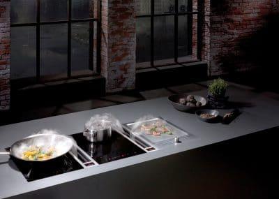 Hochwertige Küchengeräte wie der BORA Classic Tepangrill inkl. Dunstabzug oder ähnliche Marken wie Gaggenau, V-ZUG &. Co steigern den Wert einer Küche ungemein. (Foto: BORA)