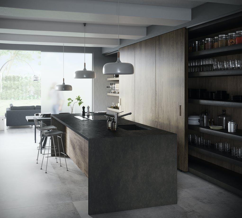 """Dekton """"Milar"""" wirkt auf den ersten Blick wie ein graubrauner Basalt und macht sich gut in hochwertigem Holz-Ambiente. (Foto: Cosentino)"""