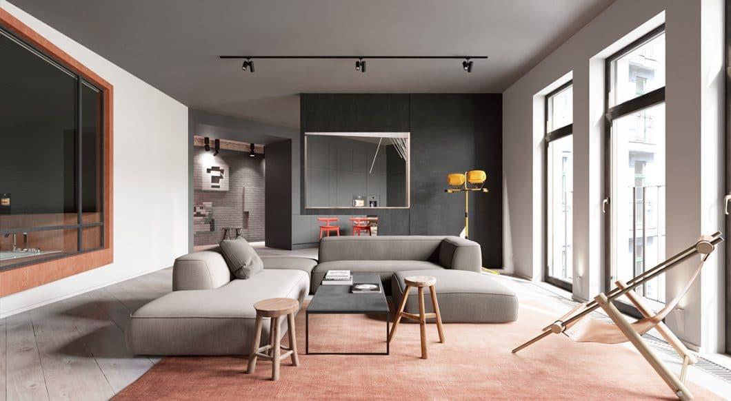 Der Raumtrenner, der zugleich als Küchenbar fungiert, verbirgt die Küche ohne Einengung vor den Blicken der Besucher - und lässt trotzdem Luft und Licht in den Raum. (Foto: Martin Architects/ Home Designing)
